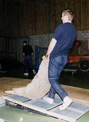 Sloping, slatted, wooden platforms are preferable for sheep dragging.