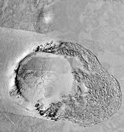 This feature, roughly 3 kilometres across, shows a rubble field pushed out from the right of a crater. This rubble looks like the piles of sea ice that form around islands in the Arctic and Antarctic.