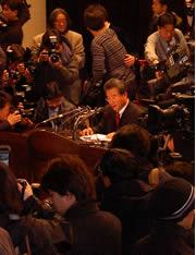 The press gather to hear the results of the university investigation.