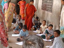 Randomized trials show local women can help improve test results in underperforming Indian schools.