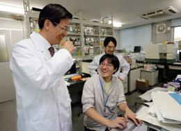 Shizuo Akira (left) shares a laugh with his colleagues Yutaro Kumagai (centre) and Osamu Takeuchi.