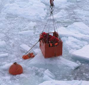 Researchers on Polarstern recover a mooring.