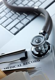 Laptop,Medical Record chart and Stethoscope