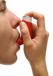 young woman with asthma inhaler