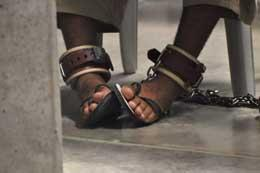 In this photo, reviewed by a US Department of Defense official, a Guantanamo detainee's feet are shackled to the floor as he attends a 'Life Skills' class inside the Camp 6 high-security detention facility at Guantanamo Bay US Naval Base, Cuba, on April