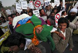 Students hold a mock funeral procession against Bt (Bacillus thuringenesis) brinjal or genetically modified brinjal (a type of eggplant) crop in the northern Indian city of Chandigarh January 28, 2010