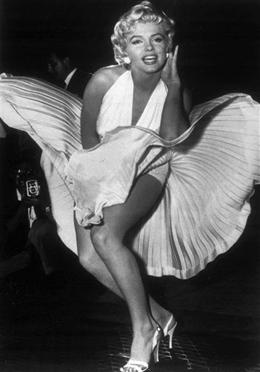 Marilyn Monroe with her white dress billowing around her thighs is seen in this September 1954 file picture during filming of The Seven Year Itch.