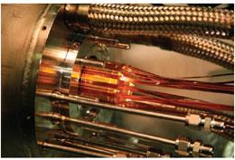 The electrodes (gold) of the trap used to combine positrons and antiprotons to form antihydrogen.