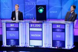 Jeopardy! champions Ken Jennings, left, and Brad Rutter, right, look on as an IBM computer called Watson beats them to the buzzer to answer a question during a practice round of the Jeopardy! quiz show in Yorktown Heights, N.Y., Thursday, Jan. 13, 20