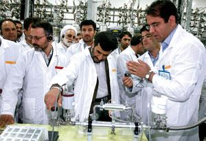 Iranian President Mahmoud Ahmadinejad (centre) visiting the Natanz nuclear enrichment facility.