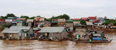 Damming the Mekong River could harm millions who rely on migratory fish, such as the fishermen in this floating village in Kandal, Cambodia.