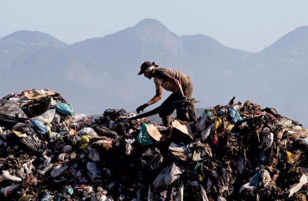 Volunteer working in landfill