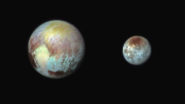 Scientists jubilant as Pluto mission phones home — safe