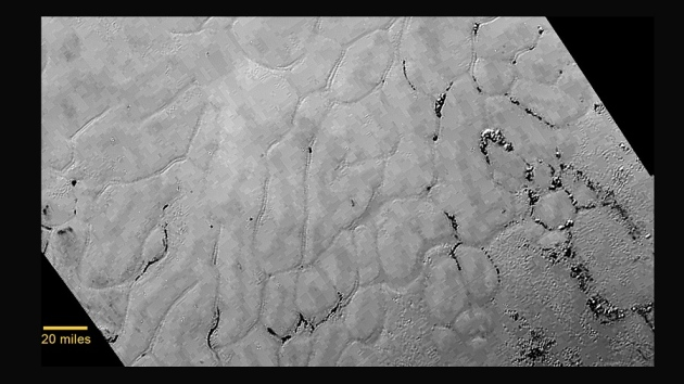 Pluto's vast icy plains and gentle hills emerge in new images