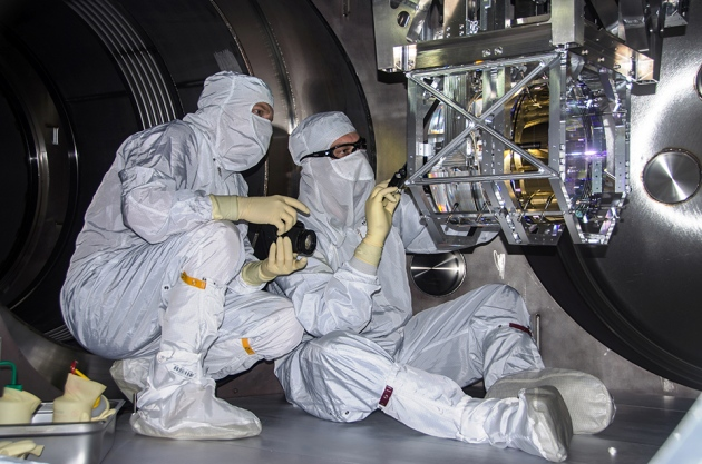 Researchers work on the LIGO observatory's detector in Livingston, Louisiana, in 2014.