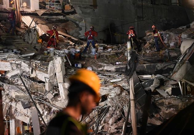 Search for Mexico quake survivors continues as hope lessens