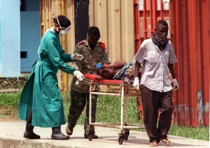 Patient with Ebola being wheeled out on stretcher