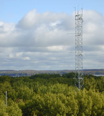 Meteorological towers like this one located in a temperate forest are distributed across ecosystems in all continents except Antarctica, providing assessments of carbon uptake by forest, grassland, desert, and crop ecosystems.