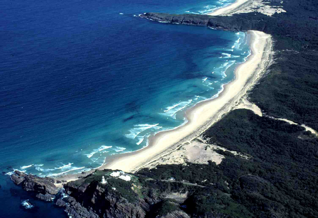 Well-developed intermediate beach containing transverse bars and rip channels along Lighthouse Beach, Australia.